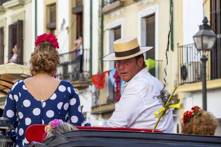 CORDOBA, SPAIN - MAY 30, 2019: Feria de Cordoba, Feria de Nuestra Senora de la Salud or Cordoba Fair participants in a horse-drawn carriage