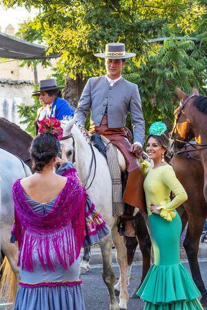 CORDOBA, SPAIN - MAY 30, 2019: Horse riders and beautiful dressed women at the procession of Feria de Cordoba, Feria de Nuestra Senora de la Salud or Cordoba Fair Editorial