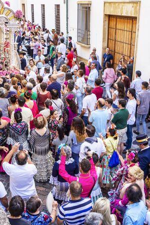 CORDOBA, SPAIN - MAY 30, 2019: Elevated view of the procession of Feria de Cordoba, Feria de Nuestra Senora de la Salud or Cordoba Fair in front of the Mosque-Cathedral