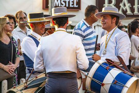 CORDOBA, SPAIN - MAY 30, 2019: Three male musicians at the procession of Feria de Cordoba, Feria de Nuestra Senora de la Salud or Cordoba Fair