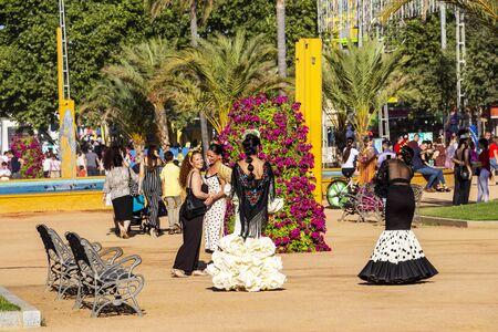 CORDOBA, SPAIN - MAY 30, 2019: Beautiful smiling dressed female participants at Feria de Cordoba, Feria de Nuestra Senora de la Salud or Cordoba Fair