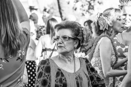 CORDOBA, SPAIN - MAY 30, 2019: Close portrait of a senior dressed female participant at Feria de Cordoba, Feria de Nuestra Senora de la Salud or Cordoba Fair