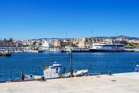 TARIFA, SPAIN - MAY 27, 2019: View of Port of Tarifa with a FRS ferry, fishing boats and the Castle of Tarifa 報道画像
