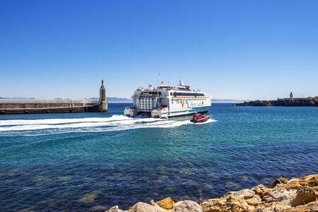 TARIFA, SPAIN - MAY 27, 2019: The Maltese Virtu Ferries catamaran Maria Dolores passes by Punta del Santo at the Port of Tarifa 報道画像