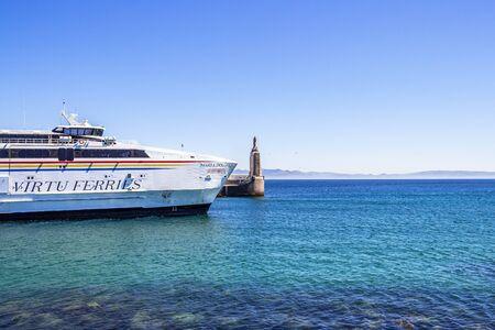 TARIFA, SPAIN - MAY 27, 2019: Punta del Santo with the Maltese Virtu Ferries catamaran Maria Dolores