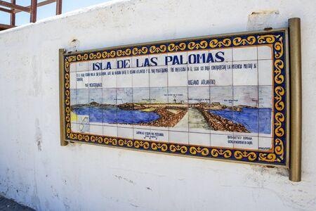 ISLA DE LAS PALOMAS, SPAIN - MAY 27, 2019: Ceramic Isla de las Palomas, the southernmost point of continental Europe, information board, sign