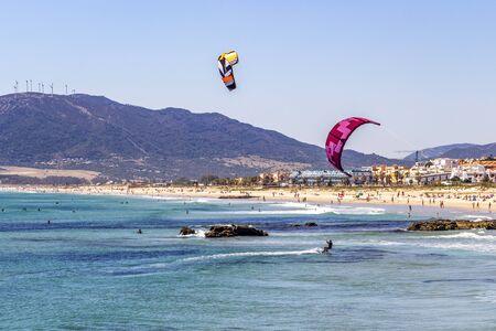 TARIFA, SPAIN - MAY 27, 2019: Kiteboarding at Playa de los Lances, Los Lances Beach, Province of Cadiz, Andalusia, Spain