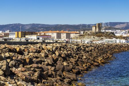 TARIFA, SPAIN - MAY 27, 2019: View of Tarifa with Castle of St. Catalina from Isla de las Palomas in Andalusia, Spain