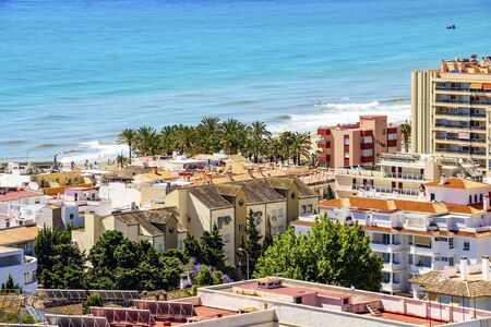 The Mediterranean Sea behind the buildings of Torremolinos, Province of Malaga, Andalusia, Spain, elevated view from the Parque de la Bateria observation tower