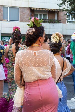 CORDOBA, SPAIN - MAY 30, 2019: Rear view of beautiful dressed female participants at the procession of Feria de Cordoba, Feria de Nuestra Senora de la Salud or Cordoba Fair