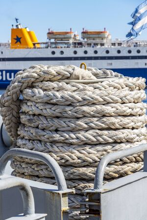 KAVALA, GREECE - JULY 20, 2018: A coil of mooring line in front of Blue Star Ferries Diagoras ship at the Port of Kavala, Eastern Macedonia, Northern Greece Editöryel