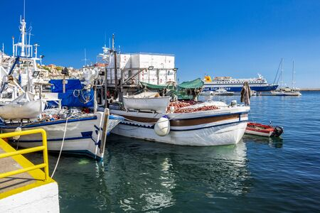 KAVALA, GREECE - JULY 20, 2018: Fishing boats and Blue Star Ferries Diagoras ship at the Port of Kavala, Eastern Macedonia, Northern Greece