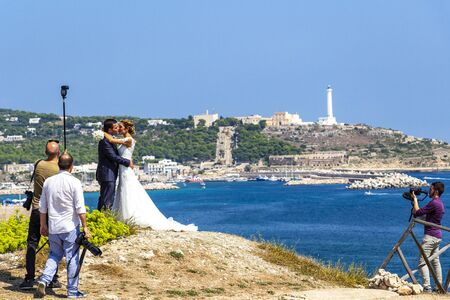 SANTA MARIA DI LEUCA, ITALY - AUGUST 31, 2018: Wedding photo session at Punta Ristola, Santa Maria di Leuca in the background, Province of Lecce, Apulia, Italy