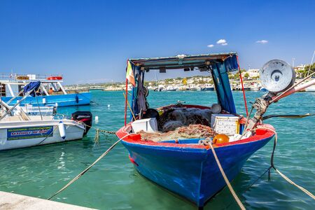 TORRE VADO, ITALY - AUGUST 31, 2018: Fishing boat at the Marina of Torre Vado, a small touristic port in Province of Lecce, Apulia