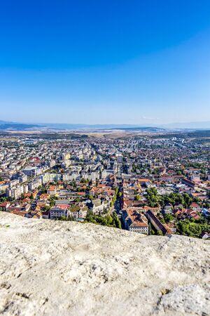 Elevated sunny city view of Deva, Hunedoara County, Transylvania, Romania from the citadel
