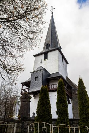 St. Peter's Church in the village of Beho, Belgium on a cloudy winter day Stock Photo