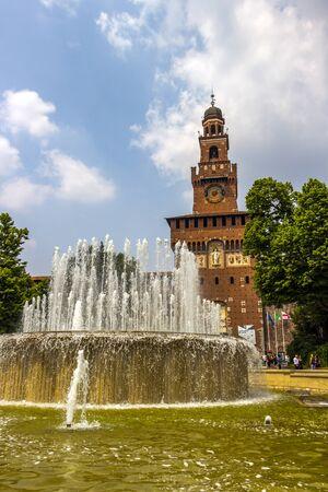 MILAN, ITALY - MAY 27, 2018: Fontana di Piazza Castello or Castle Square Fountain in front of Castello Sforzesco or Sforza Castle with Torre del Filarete in the background 에디토리얼