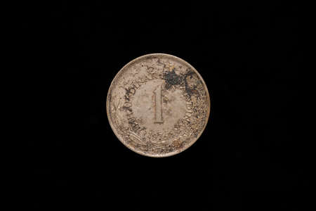 Socialist Federal Republic of Yugoslavia old stained 1 Dinar coin from 1976, reverse. Isolated on black background