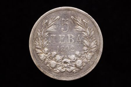 Old Bulgarian silver 5 leva coin from 1892, reverse. Isolated on black background Stock fotó