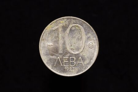 Old Bulgarian copper-nickel 10 leva coin from 1992, reverse isolated on black background