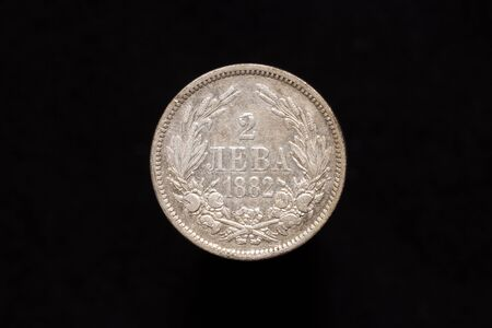 Old Bulgarian silver 2 leva coin from 1882, reverse. Isolated on black background Stock fotó