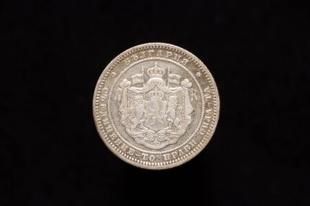 Old Bulgarian silver 2 leva coin from 1882, obverse showing the coat of arms of Bulgaria. Isolated on black background Foto de archivo