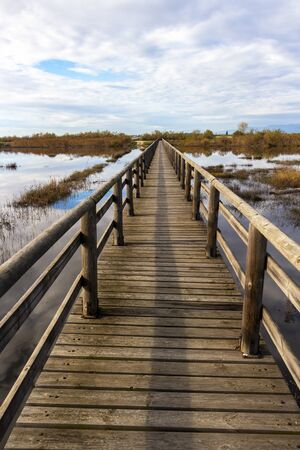 Nature wooden boardwalk in Lake Vistonida, Porto Lagos, Xanthi regional unit, Greece on a sunny winter day