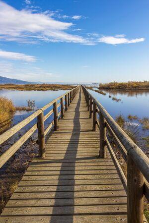 Nature wooden boardwalk in Lake Vistonida, Porto Lagos, Xanthi regional unit, Greece on a sunny winter day Stock Photo