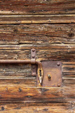 Old wooden weathered door with a rusty latch in Mantova or Mantua, Lombardy, Italy Banco de Imagens
