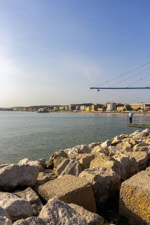 Stone blocks and shore-operated lift net at the Port of Senigallia, Province of Ancona, Marche Region, Italy, Chinese fishing net Stock fotó