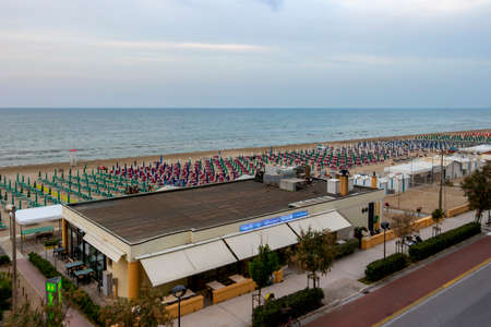 SENIGALLIA, ITALY - MAY 31, 2018: Lungomare Dante Alighieri, seafront Dante Alighieri elevated evening view with empty beaches with beach umbrellas and sunbeds lines at Province of Ancona, Marche Region