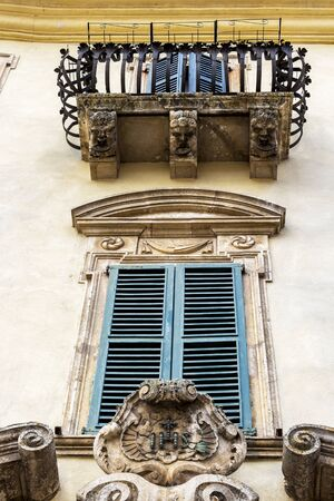 Beautiful architectural detail of Palazzo Puccetti or Puccetti Palace in Cingoli, Marche Region, Province of Macerata, Italy, balcony with balcony corbels and window low-angle view