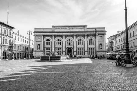 PESARO, ITALY - MAY 30, 2018: Piazza del Popolo with fountain and the building of the post office, black and white photography 新闻类图片