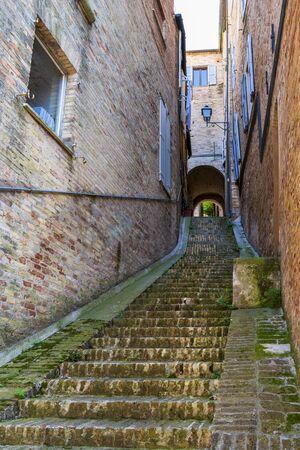Vicolo Fracassetti or Fracassetti steep narrow street view in Fermo, Province of Fermo, Marche Region, Italy