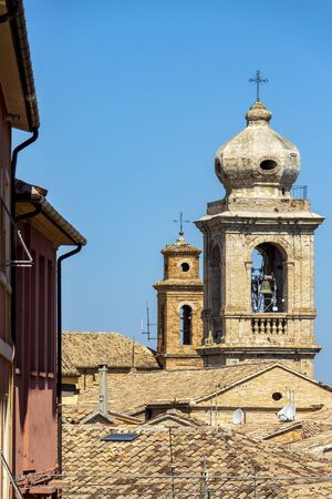 Selective focus of the bell towers of the Collegiate Church of Santo Stefano and the Convent of San Francesco in Castelfidardo, Ancona Province, Marche Region, Italy