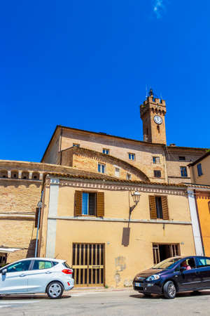 LORETO, ITALY - JUNE 01, 2018: Loreto summer sunny street view with the clock tower at Piazza Garibaldi, Garibaldi Square in the background