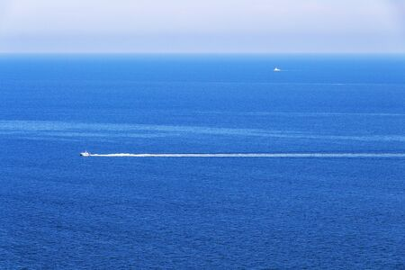 Adriatic Sea water surface elevated view from Sirolo, Province of Ancona, Marche Region, Italy with a motorboat 免版税图像
