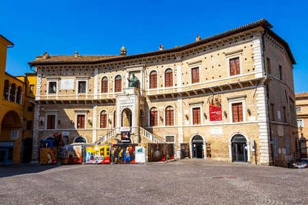 FERMO, ITALY - JUNE 01, 2018: Palazzo dei Priori, Priori Palace at Piazza del Popolo in Fermo, Province of Fermo, Marche Region, Italy on a sunny summer day