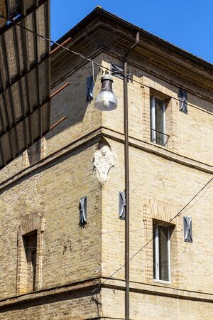 Old building beautiful decoration in Fermo, Province of Fermo, Marche Region, Italy, exterior high section partial view