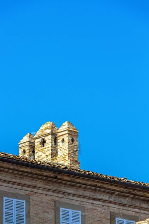Typical building rooftop with chimneys in Fermo, Province of Fermo, Marche Region, Italy