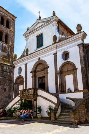 BOMARZO, ITALY - JUNE 02 2018: Church of Santa Maria Assunta facade view in the historic district of Bomarzo, Province of Viterbo, Lazio, Italy 新闻类图片