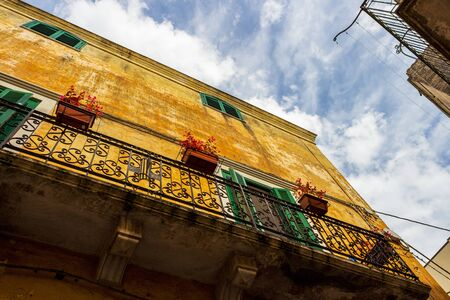 Beautiful old building in the old town of Altamura, Apulia, Italy, exterior low-angle partial view