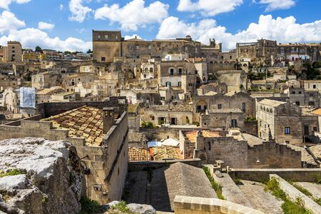 Old town panoramic sunny summer view of Matera, Province of Matera, Basilicata Region, Italy