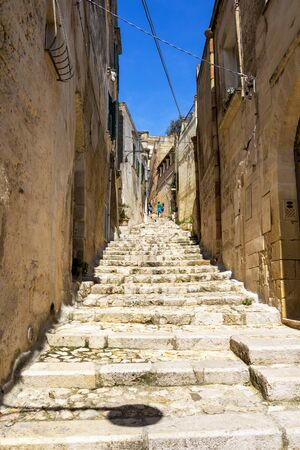 Narrow stairway street in the old town of Matera, Province of Matera, Basilicata Region, Italy