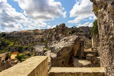 Old town sunny summer view with ancient stones in Matera, Province of Matera, Basilicata Region, Italy 免版税图像
