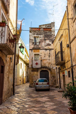 ALTAMURA, ITALY - AUGUST 26, 2018: Old town street view in Altamura, Apulia, Italy with the building of Forno Antico Santa Caterina from 1724
