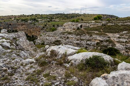 Parco della Murgia Materana or Park of the Rupestrian Churches of Matera with ancient architecture. Matera canyon panoramic view in the Province of Matera, Basilicata Region, Italy