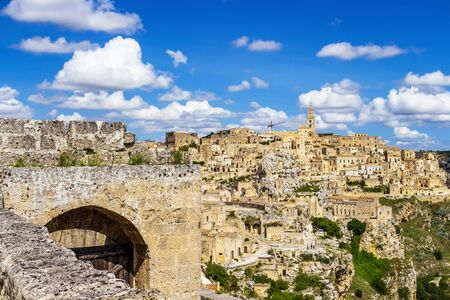 Scenic panoramic sunny summer view of Matera and the canyon of Matera in the Province of Matera, Basilicata Region, Italy