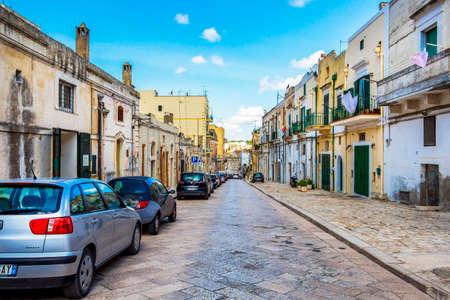 MATERA, ITALY - AUGUST 27, 2018: Via Casalnuovo or Casalnuovo Street view in Matera, Province of Matera, Basilicata Region, Italy 新闻类图片