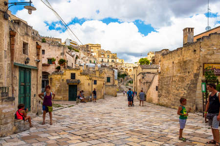 MATERA, ITALY - AUGUST 27, 2018: Touristic old town street in Matera, Province of Matera, Basilicata Region, Italy